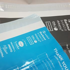 grey and blue mailing bags