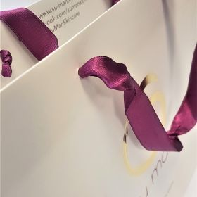 white lam ribbon handles